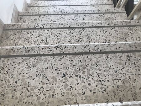 Non slip grooves made over the Treads of Staircase finished by Granite stone flooring and for steps of an high rise building fire emergency escape stairs