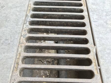 Channel gratings made of ductile iron material for drainage purpose at an car cleaning location so that dirty water runs towards through this gratings to manhole