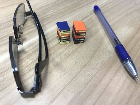 Book toys and a pen representing a life of an writer who can impose his ideas to people who like to improve their literacy level Reklamní fotografie