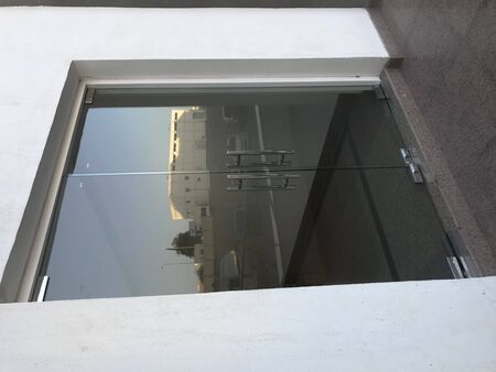 12 millimeters thick toughened Glass door with Stainless steel made tube glass Doors and its floor and lintel mounted Doors which are frame less interiors of architecture