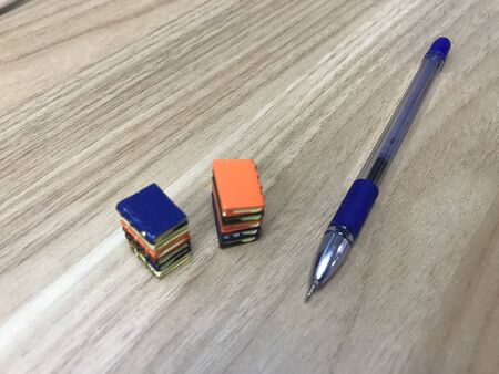 Book toys and a pen representing a life of an writer who can impose his ideas to people who like to improve their literacy level