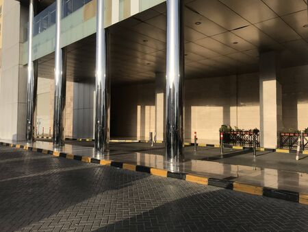 Concrete filled stainless steel finished tubular columns in an entrance of an Big shopping mall construction exterior finishes for an lucrative finishes