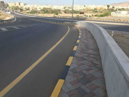 Tarmac or asphalt Road highways ways With concrete barrier along with interlocking tiles and precast concrete stones painted as per international road standards with road markings