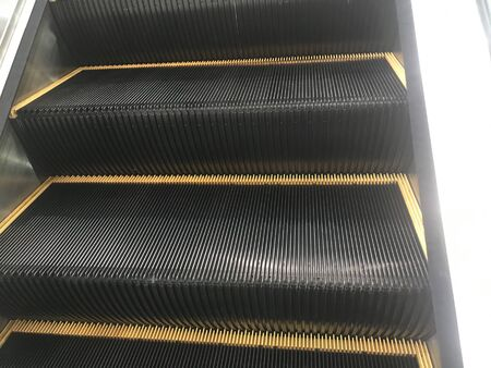 Mechanic Escalators Steel Staircase with undulating rough surface for an shopping mall to reach different levels and painted with Black and yellow enamel paint for better visibility Banco de Imagens
