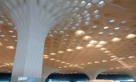 Roof ceiling design view or Square hole deck waffle ceiling for an international airport at mumbai india and emulsion painted in Sandal color ceiling view Banco de Imagens