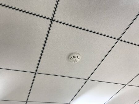 Suspended Grid Calcium silicate false ceiling interior works for an Offices building construction at an high rise building interiors with necessary mechanical electrical services 写真素材