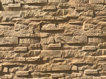 Boundary wall finishes with random fixation of stones for an residential villa building