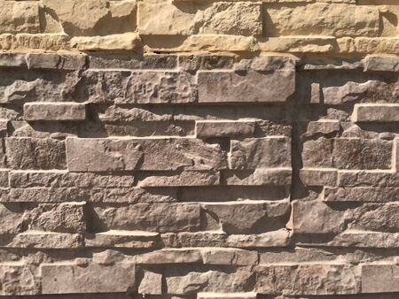 Stone pitching works for wall finishes of compound wall of an Residential villa House Banco de Imagens