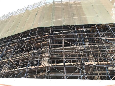Building construction is in progress using installed tower crane and activities like concreting and reinforcement and scaffolding to deliver to client