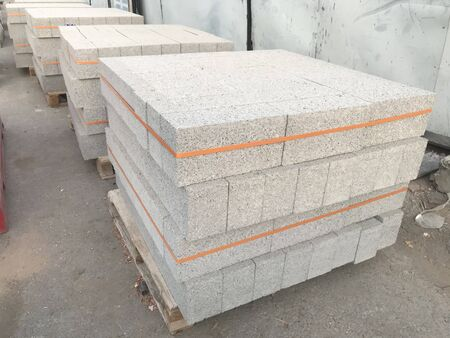 concrete Solid or hollow block stones are stacked on wooden pallet for construction of Wall and partitions works 免版税图像
