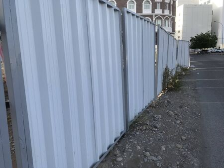 Temporary fencing done using galvanized steel pipes and corrugated steel pipes for an real estate work of building construction activities as per municipality