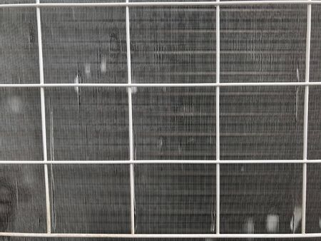 Window air conditioner Grill background with steel small pipes fixed for the residential building exterior side