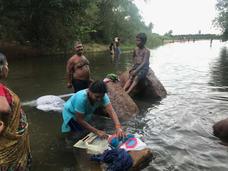 People from family altogether enjoying the natural water source in an indian forest and enjoying their vacation or holidays 新聞圖片