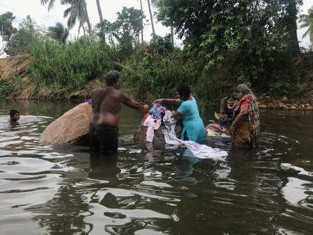 People from family altogether enjoying the natural water source in an indian forest and enjoying their vacation or holidays 版權商用圖片