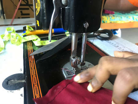 Clothes are under stitching process by an Indian working lady