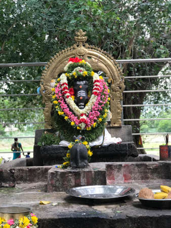 Black stone God Ganesh at Forest temple above an stone made platform at india