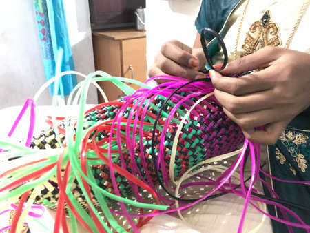 handmade plastic wire bag is being prepared at home by an lady who doing selling business