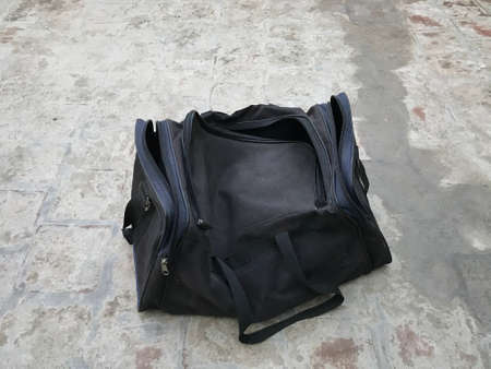 Black color Bag has left at concrete floor and being unattended makes suspicious or bomb or terrorism attack