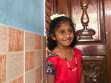 Five year old indian Girl posing for an portrait image for an family album