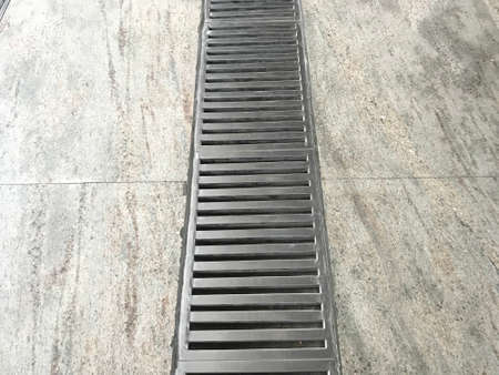 Stainless steel power coated or fabricated Floor Drain longitudinal Gratings at metro station floor marble flooring for drainage purpose 版權商用圖片 - 157644099