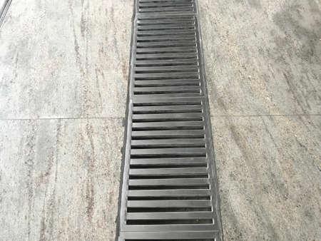 Stainless steel power coated or fabricated Floor Drain longitudinal Gratings at metro station floor marble flooring for drainage purpose 版權商用圖片
