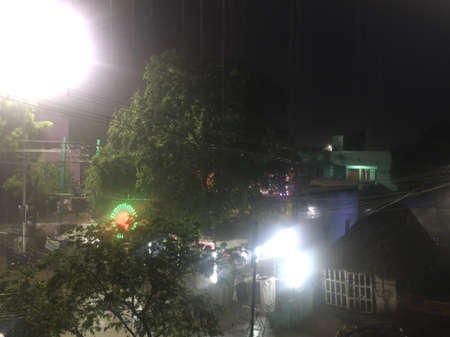 Raining heavily with the wind in the street and LED lighting background