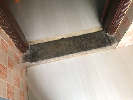 Stone made threshold at the doorstep of an house or home construction 版權商用圖片