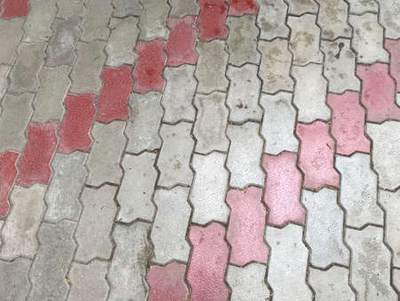 Cement concrete interlocking tiles of Grey and white color for outdoor walking can be slippery while wet 版權商用圖片 - 158090126