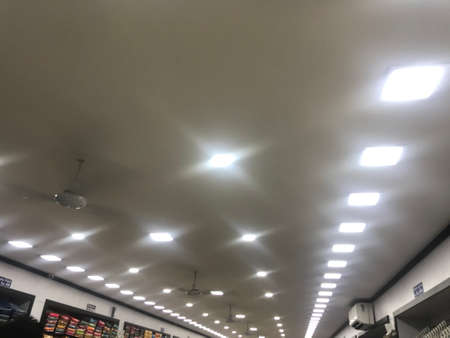 Gypsum false ceiling design with White LED lighting for an textile shop commercial