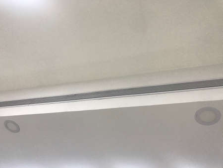 Suspended Gypsum reflected false ceiling design or designs made at corner of large area decoration for an commercial shopping mall