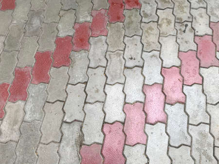 Cement concrete interlocking tiles of Grey and white color for outdoor walking can be slippery while wet 版權商用圖片