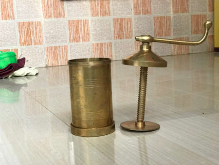 copper made Idiyappam snacks maker images and which is famous tool used in kitchen 写真素材 - 158464058