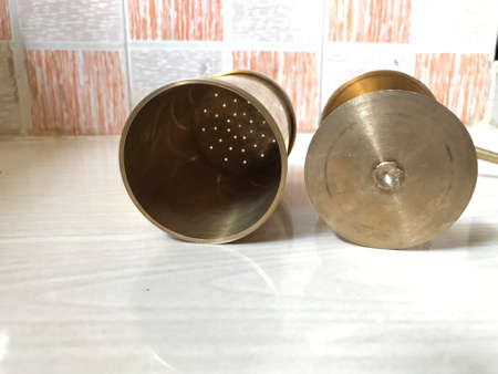 copper made Idiyappam snacks maker images and which is famous tool used in kitchen 版權商用圖片