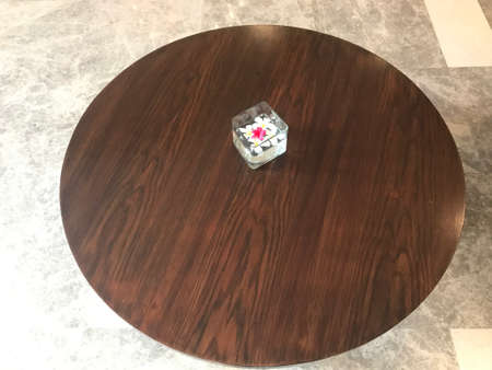 Circular wooden table made of teak wood and finished with wooden laminate or veneered 版權商用圖片