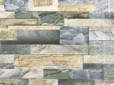 Exterior stone cladding tile design for an high rise building for first two floors architecture
