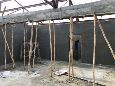 Beam concrete using an bamboo support and shuttering for bottom in an Industrial projects construction site or project 版權商用圖片