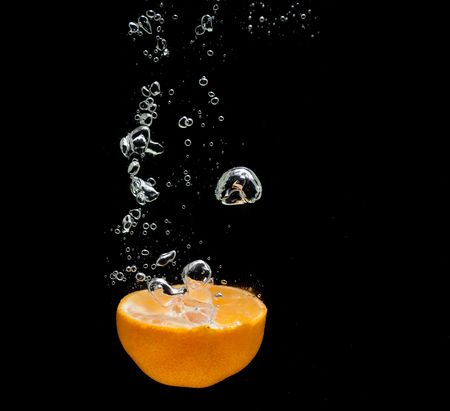 Orange in water photo
