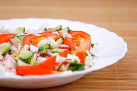 side dish: Side dish with green cucumber and red tomato