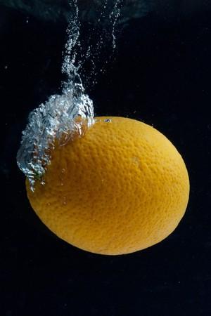 Orange and splash water Stock Photo - 8037803