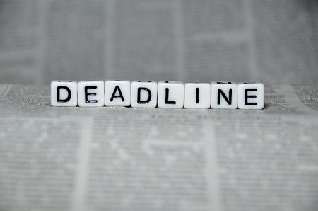 job deadline: DEADLINE word on top of newspaper