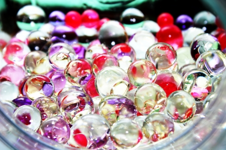 Colorful glossy balls in bottle Stock Photo