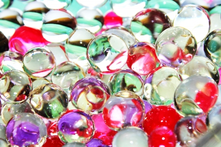 Colorful glossy balls in bottle close up