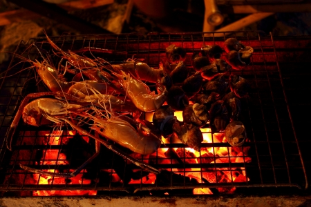 outdoor cooking seafood on beach at night