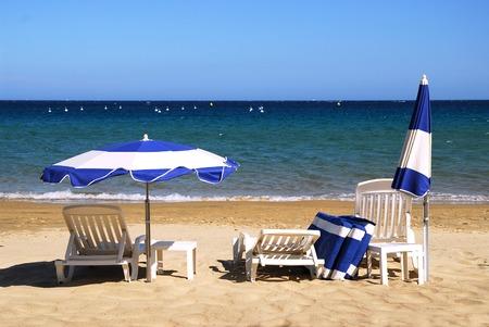 sunshades: parasol and deckchair