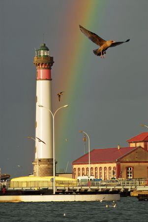 vertical orientation: Lighthouse and rainbow