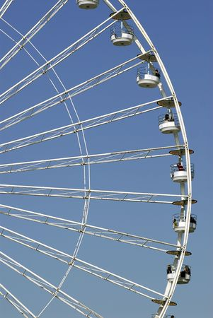 the height of a rim: Famous big wheel or ferris wheel  in Paris on blue sky background