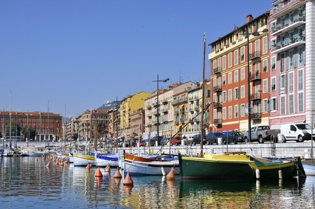 Boats in the port of Nice in southeastern France,department Alpes-maritimes, with colorful buildings photo