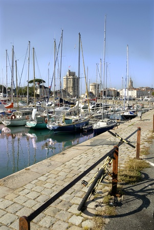 Port of La Rochelle in France with a bike in the foreground, region Poitou Charentes, Charente Maritime department Imagens