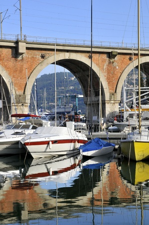 maritimes: Port of La Rague in France, department Alpes maritimes, with a rail aqueduct in the background