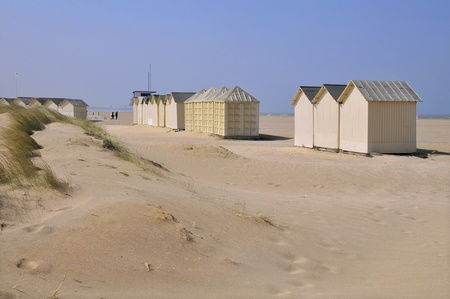 Beach cabins and dunes at Ouistreham in the Calvados department in the Basse-Normandie region of France photo